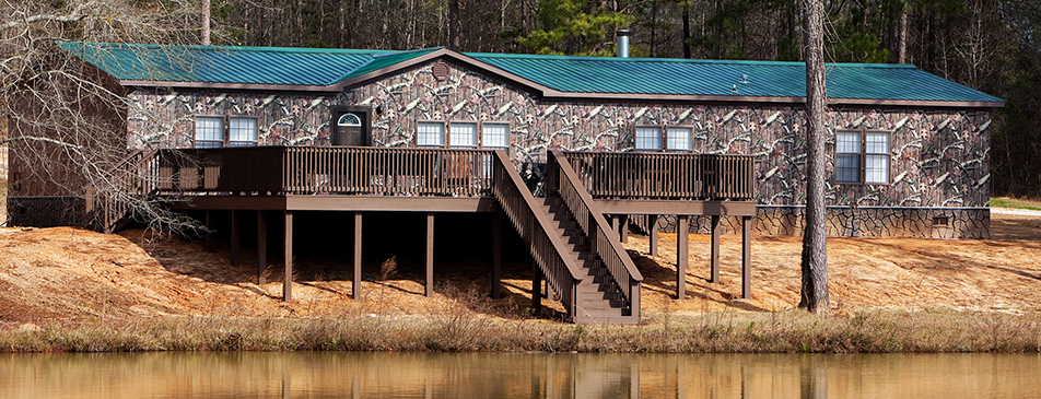 Kid Rock's hunting cabin wrapped in Mossy Oak Graphics